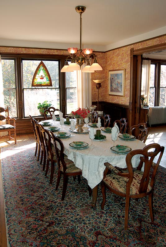 The right light fixture can top off a room perfectly, as evidenced in this Victorian dining room, complete with gas-electric chandelier.