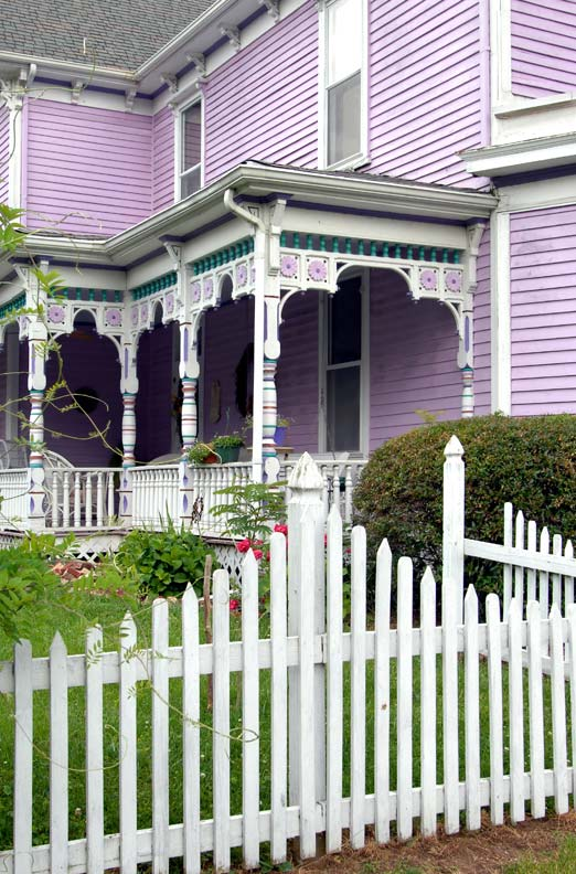 This Victorian porch is bright, but limits accent colors to two families.