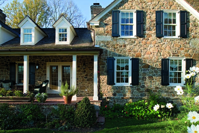 Peter Zimmerman Architects designed this stone house following the vernacular style of the region—Pennsylvania Dutch. Salvaged stone and brick were used in the construction of the building.
