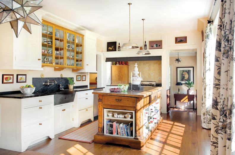 The welcoming country kitchen offers a large farmhouse sink and a center island workstation.