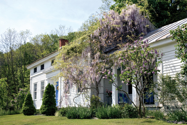 Pilasters and frieze windows are defining elements of this country Greek Revival house in New York State.