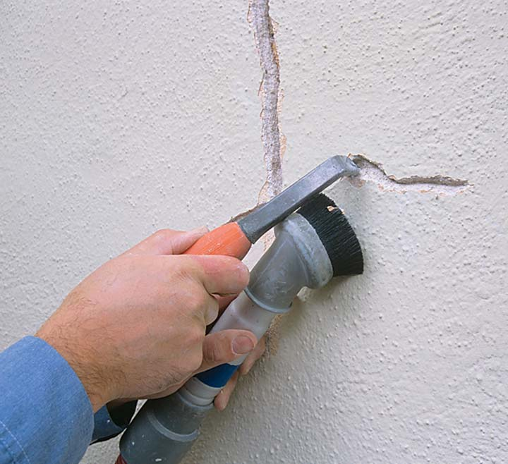 Plaster repair: Cyclical cracks are the bane of antique walls and must be repaired with care to avoid reoccurence. First, dig out the crack in an inverted V that undercuts the plaster, vacuuming out all the debris.