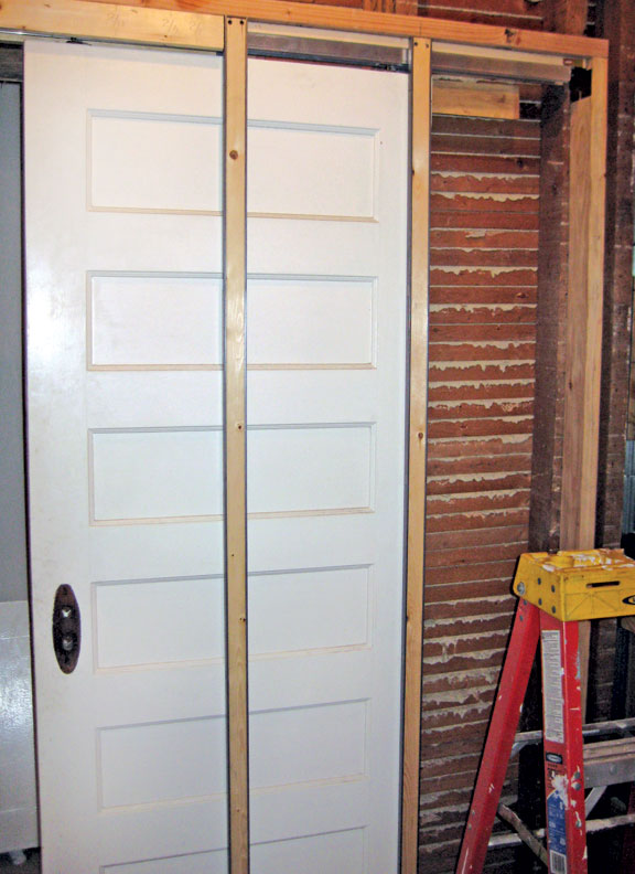 Pocket Door Kits come with two split jambs; one is installed next to the header, and the other halfway down the wall.