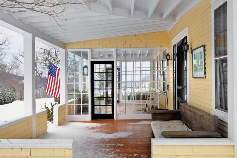 Porches buffer the house in the savage Vermont winter.