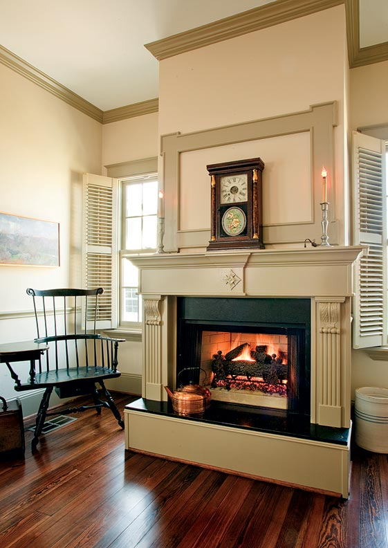 The kitchen sitting area boasts an eclectic style, with Early American millwork and a Federal-style mantel.