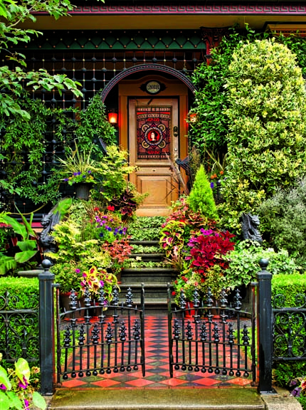 Victorian front porch with stained-glass door