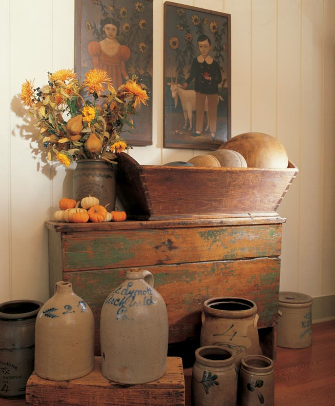The two newly created primitive portraits accompany rustic crockery in a Virginia farmhouse dining room