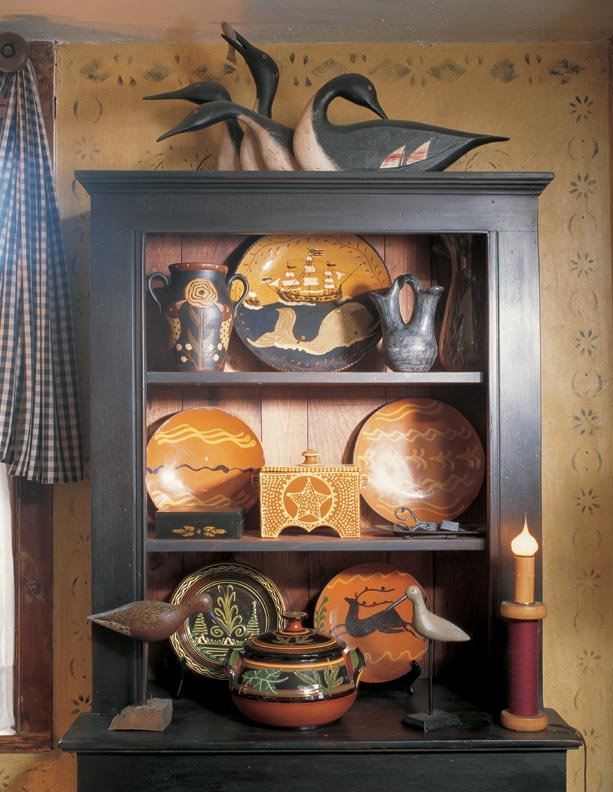 Against period stenciling, the cupboard is a well-made new piece.