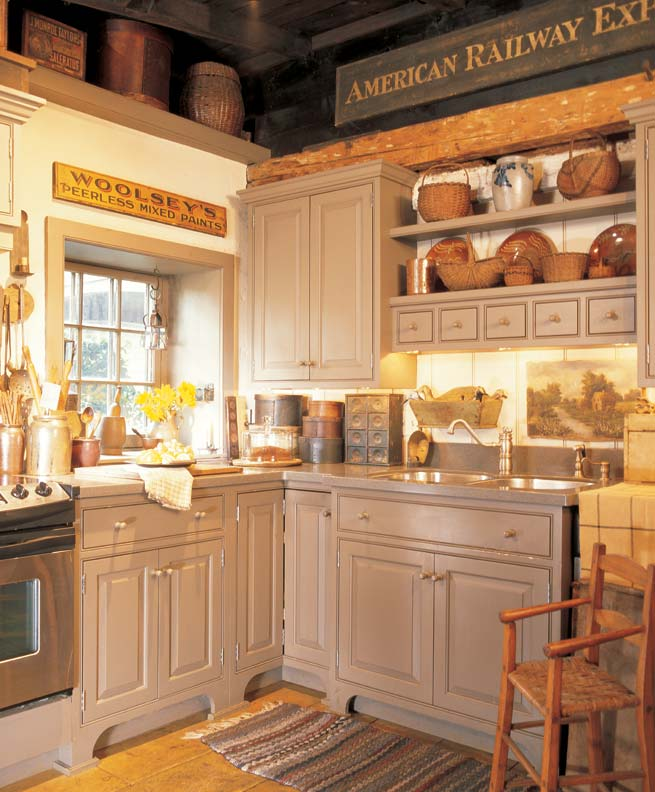 Primitive collectibles and wares backdate a sensitively designed new kitchen.