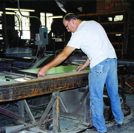 Sheets of steel are still hand-cut with shears at W.F. Norman. (Photo: Lee Ann Russell)