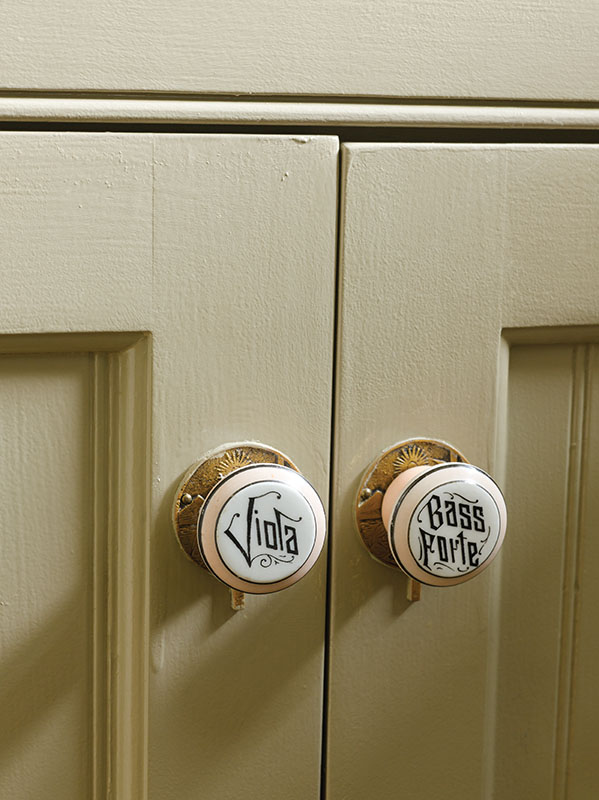 Pump-organ knobs dress up the new kitchen.
