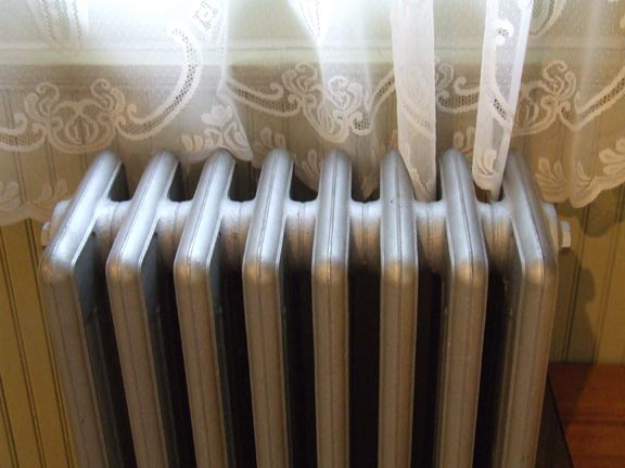 Steam radiators connected across both the top and bottom can be converted easily to run on hot water.