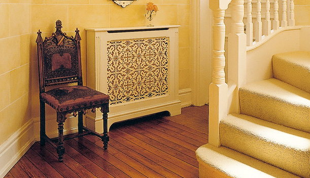 A decorative grille turns a radiator into furniture; the radiator can be built into a larger piece, as well. (Courtesy:  Fichman)