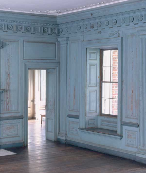 Raised-panel shutters fold back into deep window recesses at Drayton Hall, an 18th-century mansion in Charleston, South Carolina.