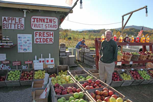 This farmstand in Sperryville sells produce and cider from local orchards. Owner Roger Jenkins packs a crate behind his father-in-law, Randolph Clater.
