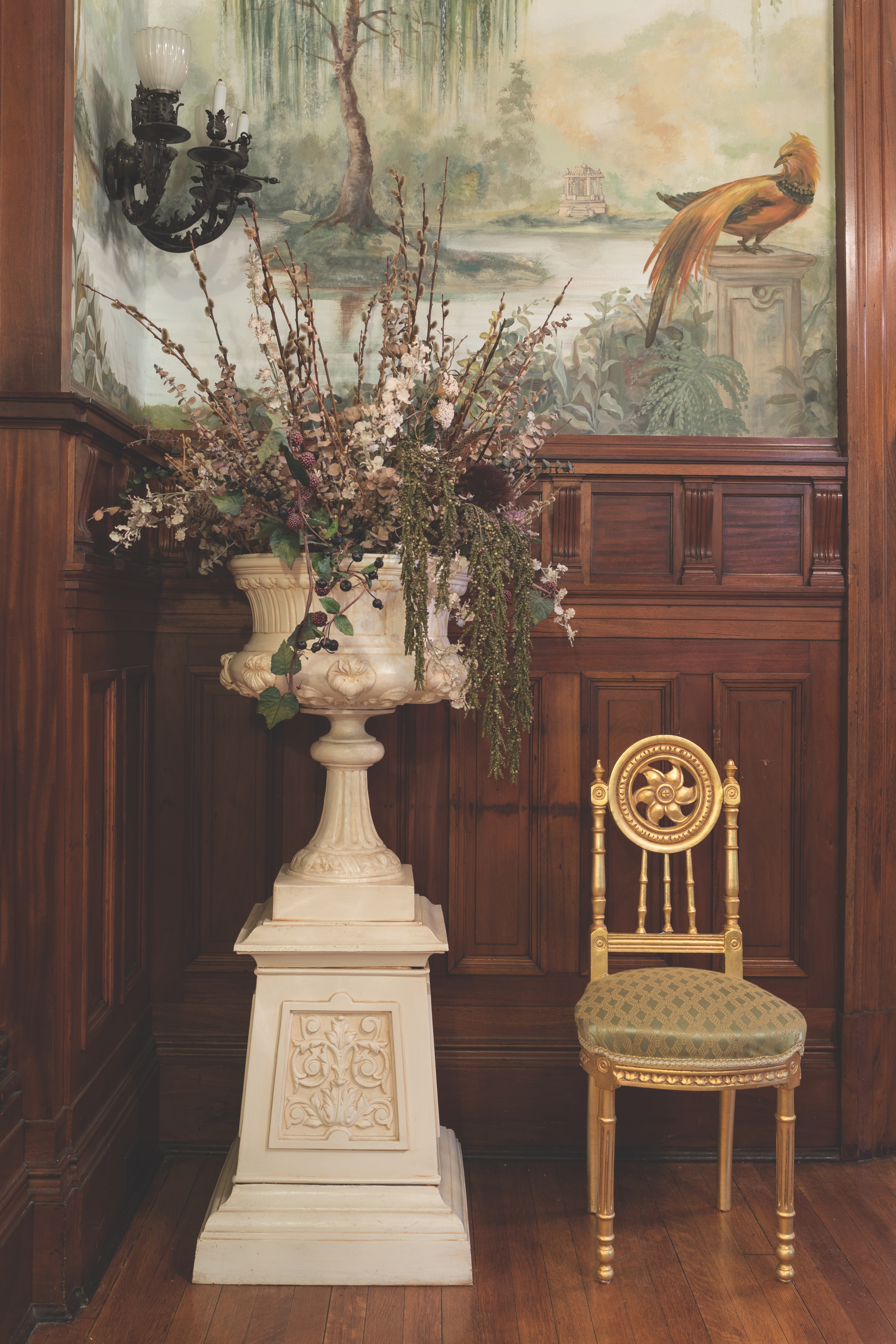 The owner painted these murals  of Forest Park, the nearby site  of the 1904 St. Louis World's Fair,  in the entry and reception  hall, to recall the Fair's  romantic gardens.