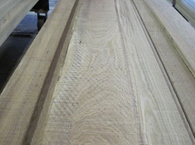 Recovered White Oak lumber caricature grade: wormy, distressed, rustic and other common grade lumber.