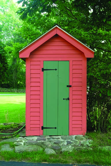 Red garden shed with iron strap hinges, stylish sheds