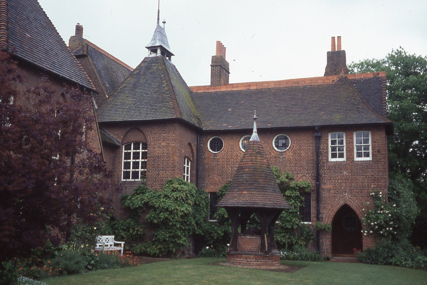 At Red House, William Morris's first home and garden, the showy patterned plantings typical of Victorian gardens are eschewed in favor of ornamental fruit trees and climbing roses.