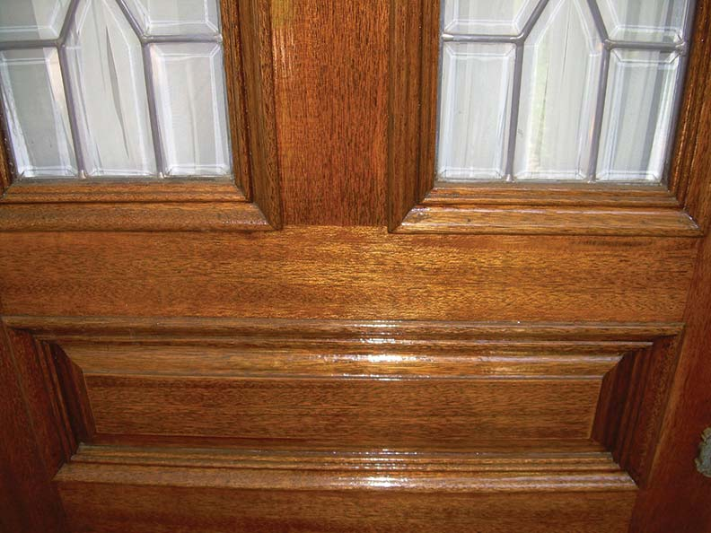 Stained and varnished entry door