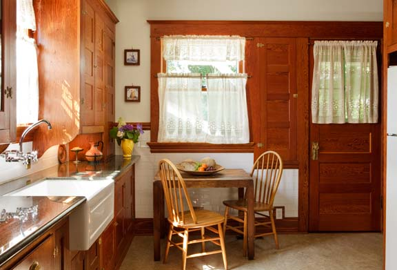 Refinished original built-ins, cabinets, and trim have a character rare in remodeled kitchens.