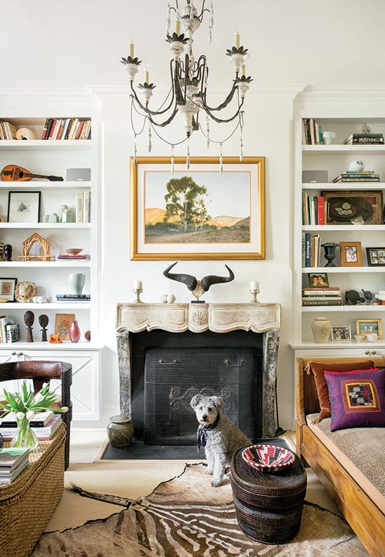 Tribal art from Barnes' native South Africa enlivens the living room.