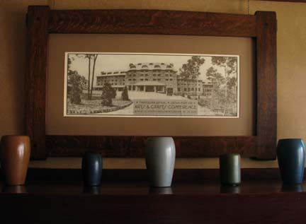 A collection of Marblehead pottery keeps company with an archival photo of the Grove Park Inn.