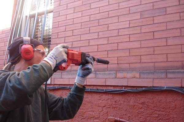"Masonry ties are ideally installed in the mortar joints. This requires skill on late 19th century ""butter joints"" which are both incredibly narrow and usually colored to match the brick."