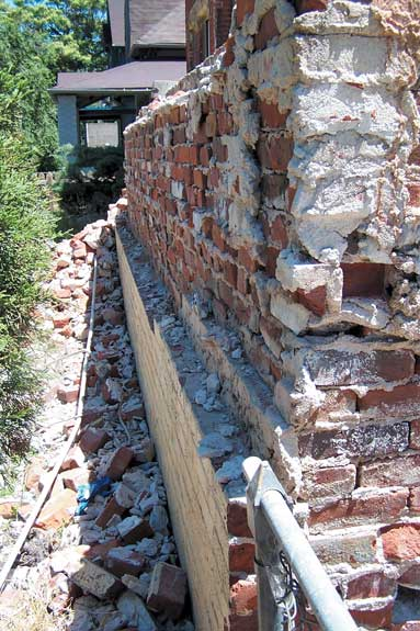 Though the bulk of many historic brick walls are composed of common brick that is hidden from view, what we see on the exterior is a layer of veneer brick—here peeled off the wall.