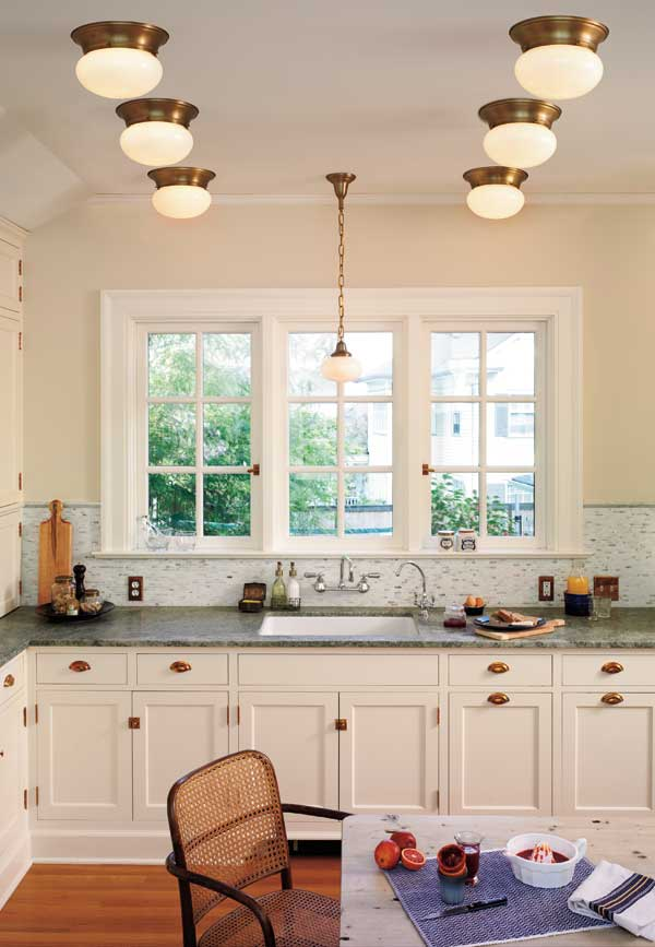 Replace old recessed lighting with a conversion kit, then mount flush fixtures like Rejuvenation's 'Porter' over the old openings.