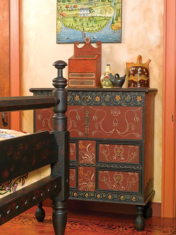 The black scroll-decorated chest by Charlie Coombs is based on a 17th-century Connecticut original.