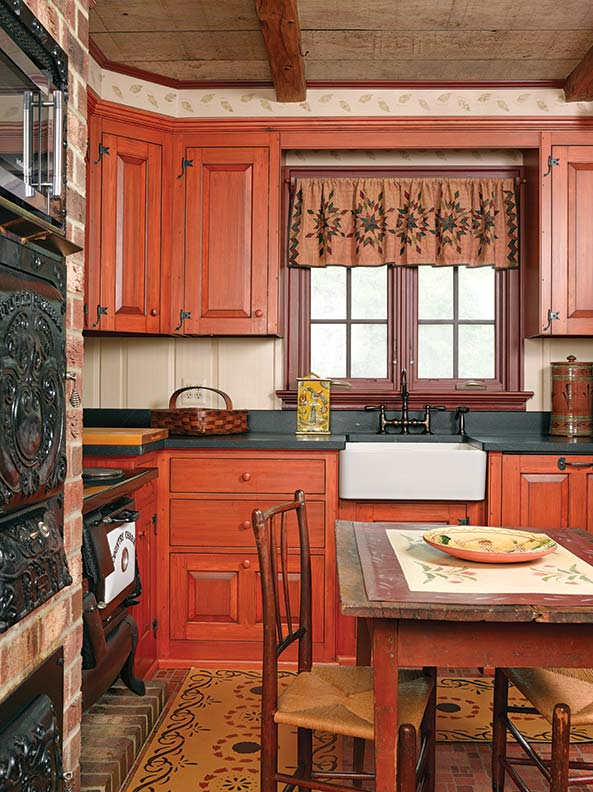 """Cabinets are Kennebec's Grover Tavern style in hand-planed pine: """"The patina continues to get better."""" Countertops are from Vermont Soapstone."""