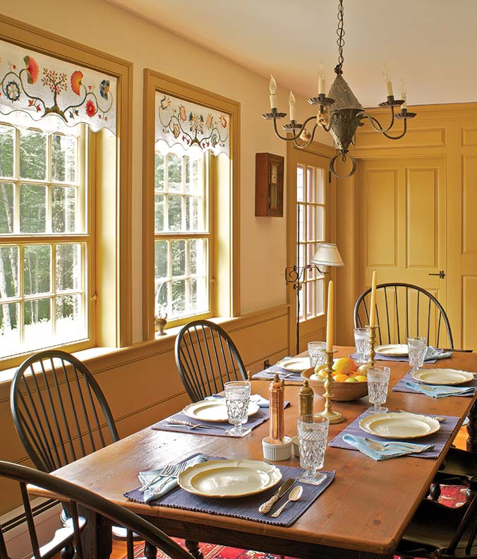The kitchen wing includes an informal dining area with a fully paneled fireplace wall.