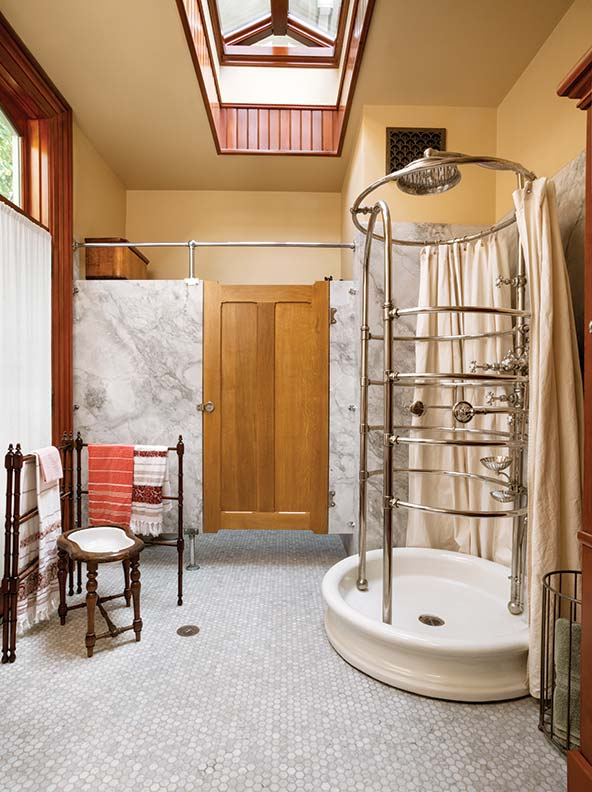 A hex-tile floor, swinging door set into marble walls, and wood wainscot in the sink and toilet area all are based on 19th century models.