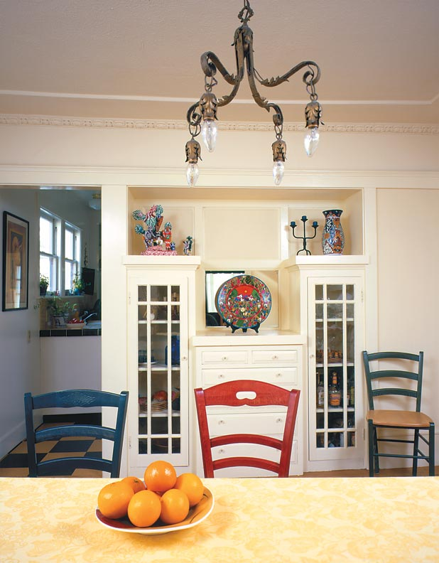 All it took to revive the charm of this bungalow dining room with original built-ins was a little fresh paint and an appropriate light fixture.