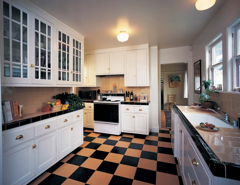 Keeping old kitchen casework (bottom), but adding newly milled flat-panel doors, tile countertops, and fresh paint enhances value at low cost.