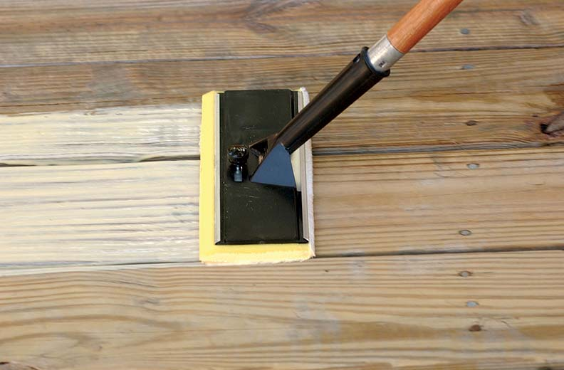 Applying stain or sealer with a sponge mop will save your knees.