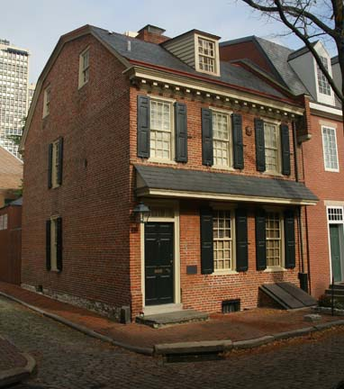 The projecting pent eave between floors and the plain doorway on the 1758 Rhoads-Barclay house are typical of earlier homes.