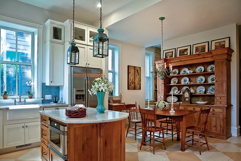 An antique hutch creates warmth in the dining area.