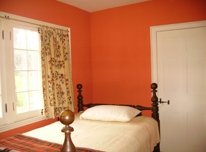 """Robert Miss painted a bedroom with Cottage Rose milk paint and a 6""""-wide whitewash brush to get authentic texture as well as color."""