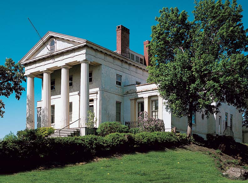 The Hervey Ely House, fronted by a prominent portico and Doric columns, is textbook high-style Greek Revival.