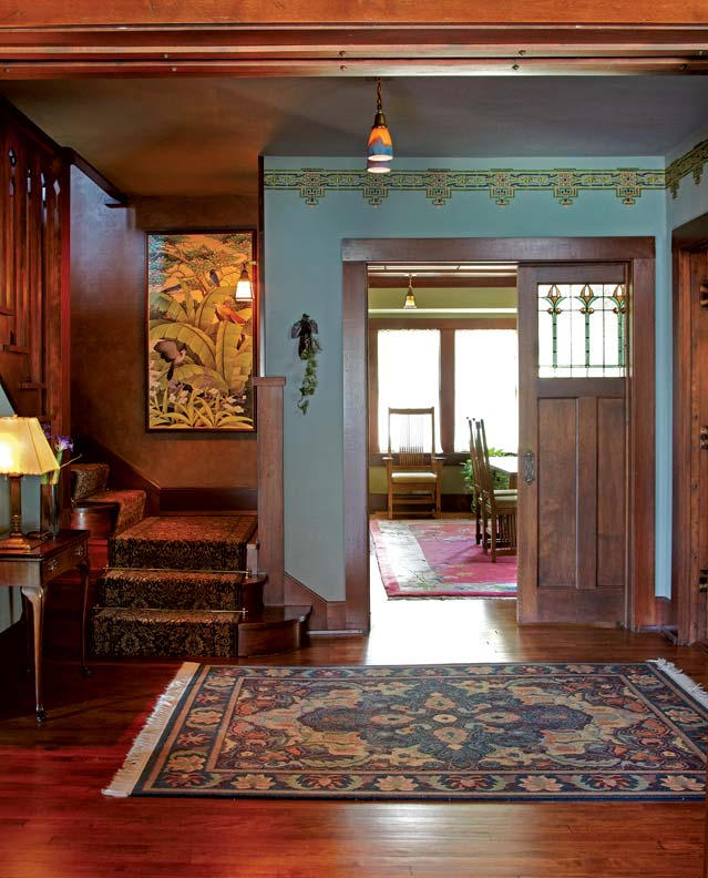 Sarah Bell hand-painted the geometric frieze in the front hall, which is based on a vintage design.