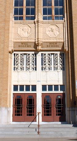 Images of the school's namesake crown the doors to Will Rogers High School.