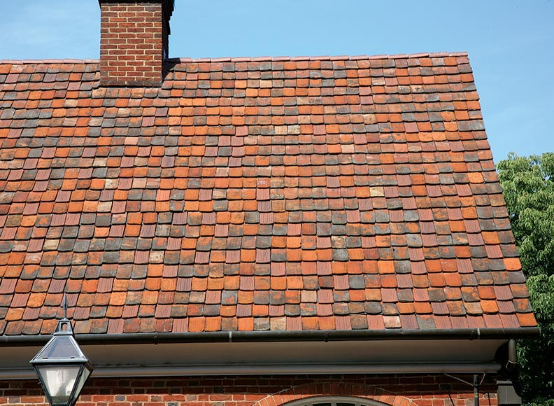A variegated tile roof adds character to a building at the Moravian settlement in Old Salem, North Carolina.