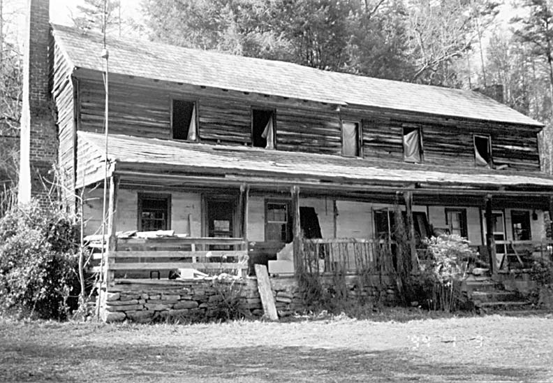 Rotten sills had caused the house, unoccupied for two decades, to sink toward its center.
