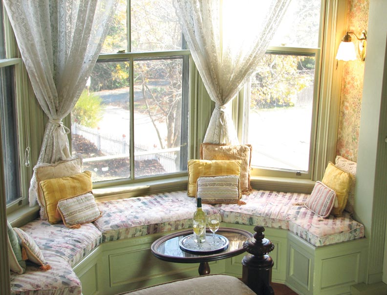 Whether the room is circular or polygonal, a good way to design built-ins like window seats is with a series of angled panels.