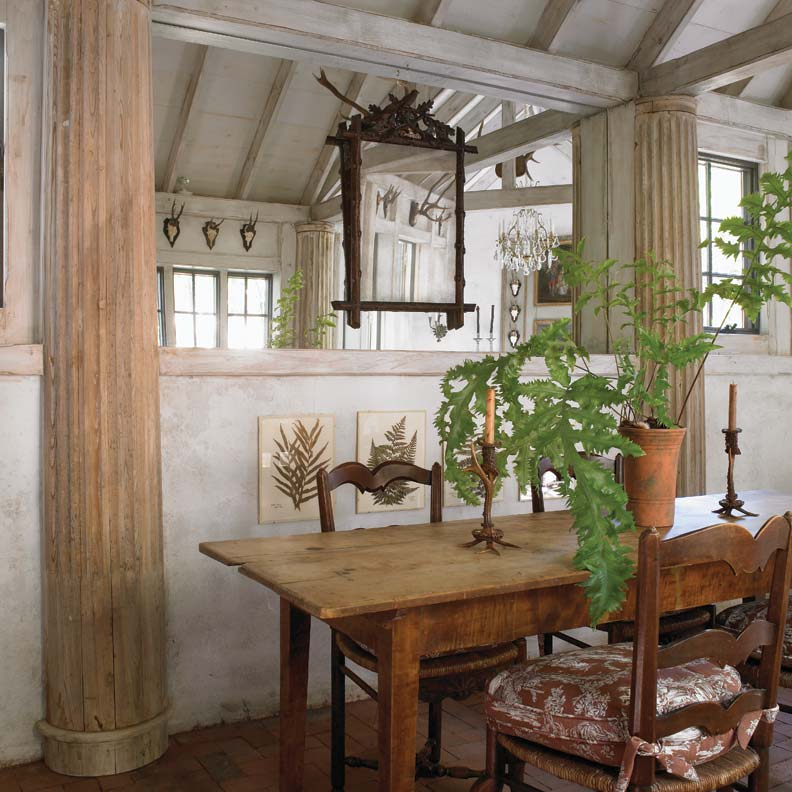 Salvaged pilasters help to cordon off the dining area.