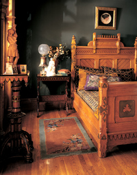 The chestnut bed with ornamental strapwork was made by Kimble & Cabus, one of the foremost producers of Modern Gothic, or Eastlake-style, furniture.