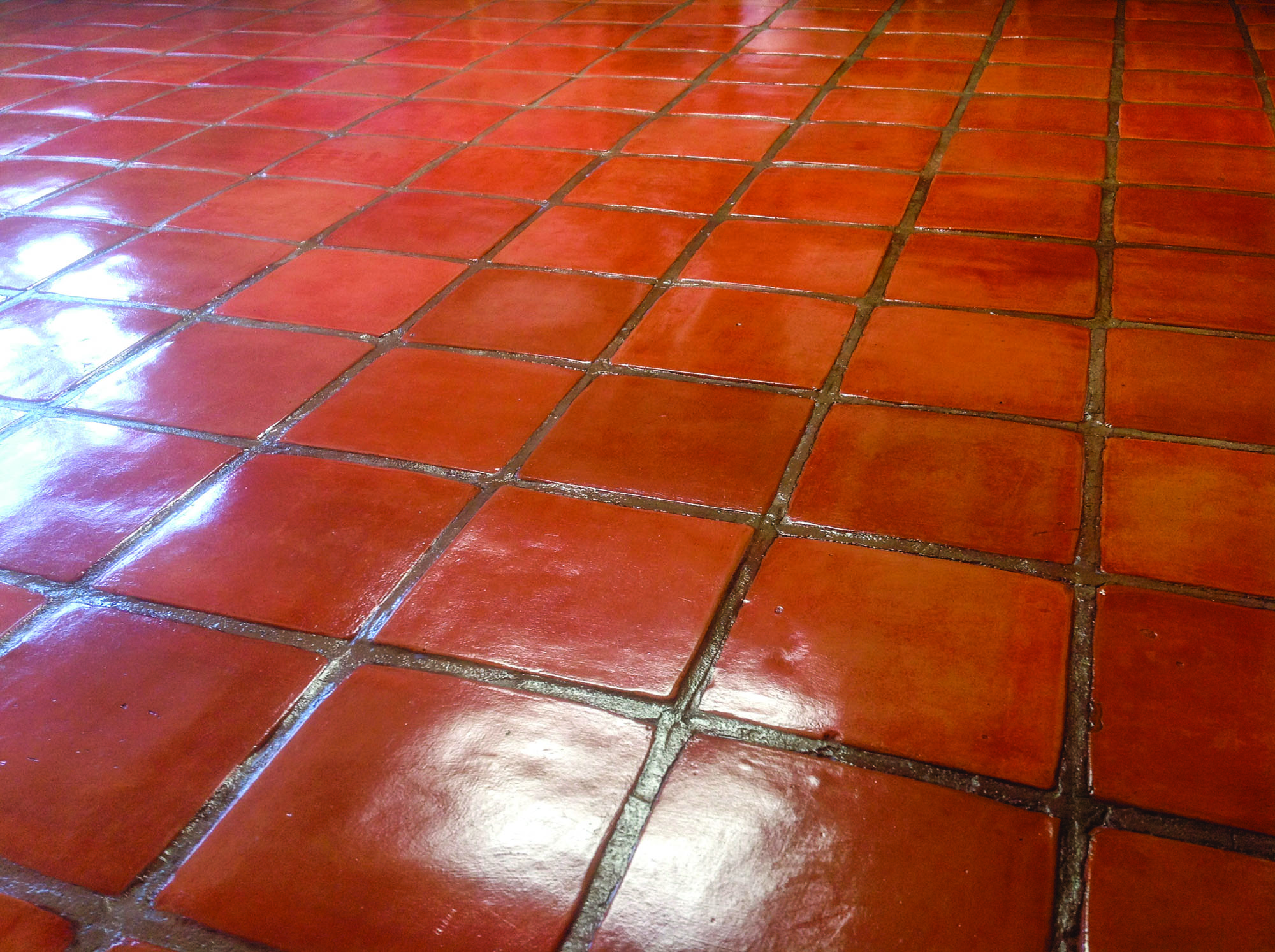 A Saltillo-tile floor, as professionally cleaned and buffed by California  Tile Restoration.