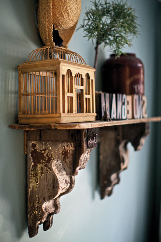 Paired with salvaged fence boards, a pair of antique corbels becomes a display shelf.